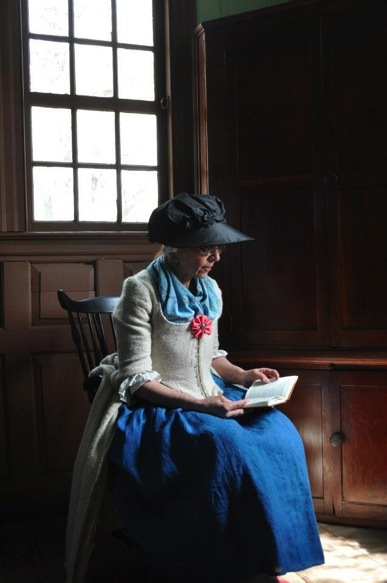 Ramona Invidiato in the ladies' parlor in the Carter Mansion, Elizabethton, Tennessee, reading from her pocket 1733 King James New Testament.  This photo was taken at the  John and Landon Carter Mansion, Elizabethton, Tenessee.
